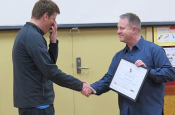 Michael Krammer receives his certificate from Richard Benge