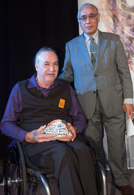 David Cameron, presented the Arts Access Artistic Achievement Award 2016 by senior Maori artist Darcy Nicholas