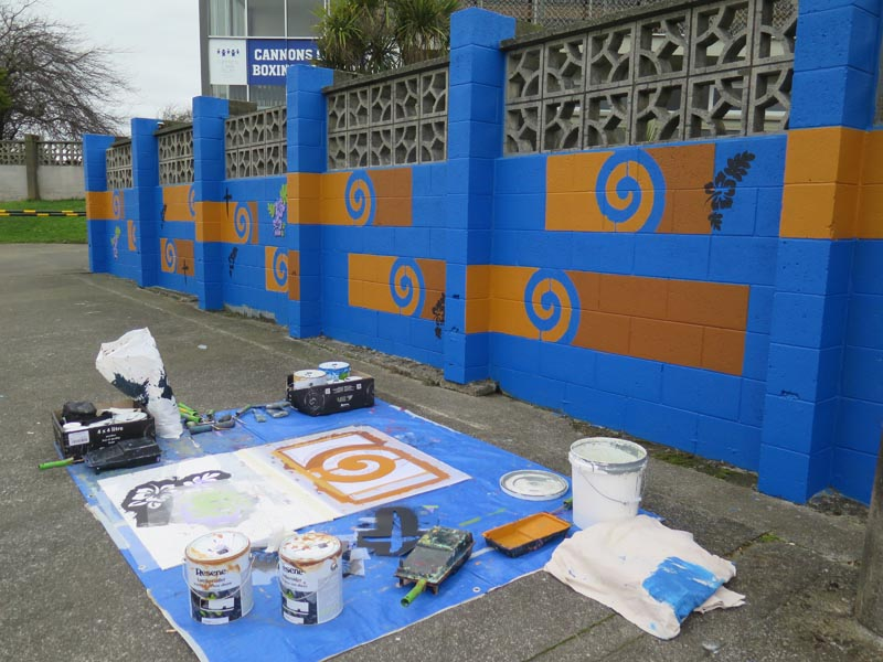 Paint, rollers and stencils needed to paint the mural
