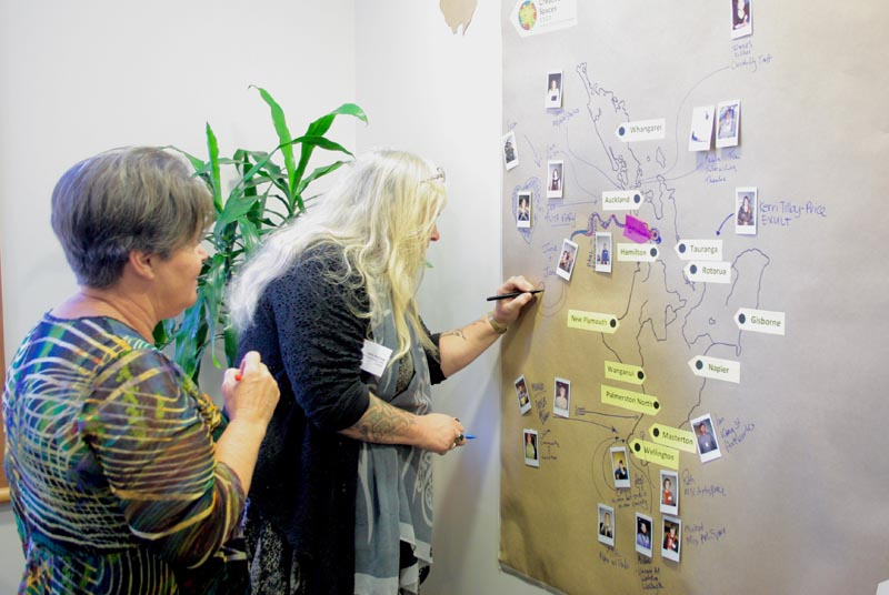 Delegates at Creative Spaces 2020 mark their place on a map