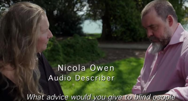 Audio describer Nicola Owen talks to blind consultant Paul Brown in the video Arts For All