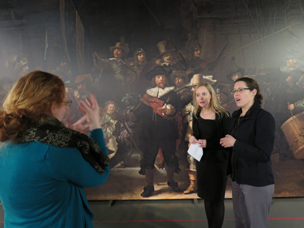 Teresa Cooper learns about Rembrandt's paintings from Dr Erin Griffey, with assitance from sign interpreter Bridgette Strid, before becoming a Deaf tour guide for the Rembrandt exhibition at the NZ Academy of Fine Arts