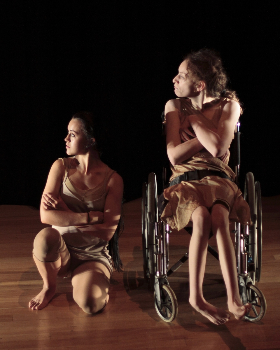 two dancers one in a wheelchair sitting side by side