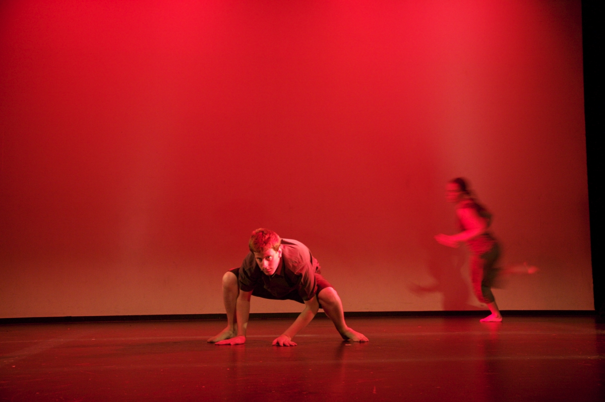 Two dancers on a red stage