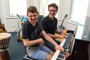 Two pianists smiling