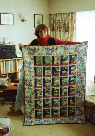 June Nixey in 1996 with the quilt she swapped for a painting