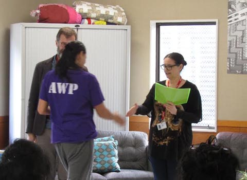 Pip Adam presents a certificate to a woman in Arohata Prison who graduated from a creative writing course