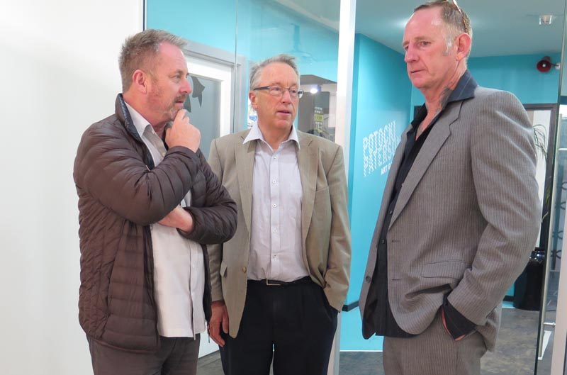 Richard Benge and Howard Fancy of Arts Access Aotearoa talk to Simon Kerr at the exhibition opening