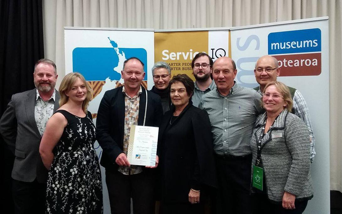 Richard Benge, left, with Te Manawa staff