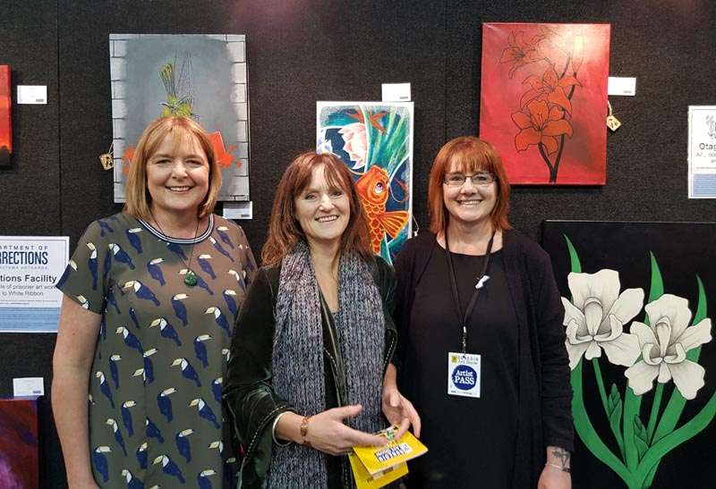 Sherie Lucke with Deputy Prison Director, Lyndal Miles and Interventions Co-ordinator, Sacha Bignell at the Dunedin Art Show