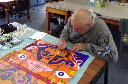 An artist at work at Otautahi Creative Spaces