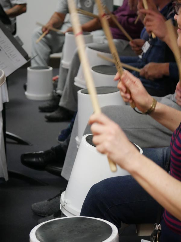 Drumming in a Christchurch Symphony Orchestra workshop with men in the Navigate Unit of Christchurch Men's Prison