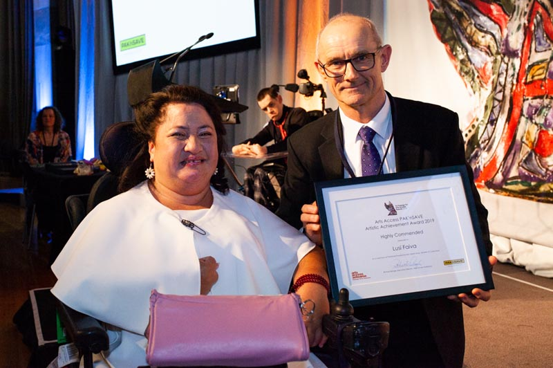 Lusi, with award sponsor Kieran O'Sullivan, receiving her Highly Commended certificate at Te Putanga Toi Arts Access Awards 2019
