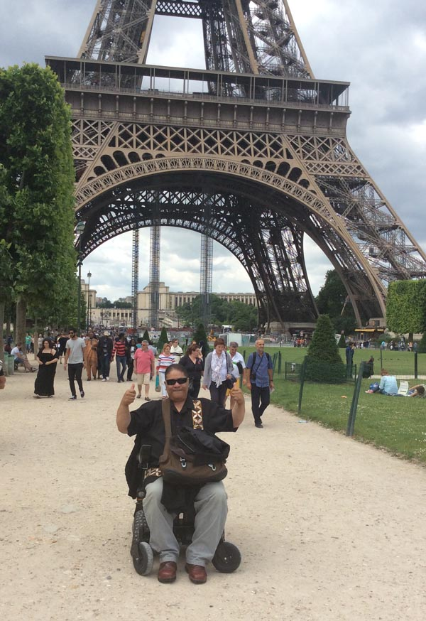 Pati Umaga in front of the Eiffel Tower in Paris