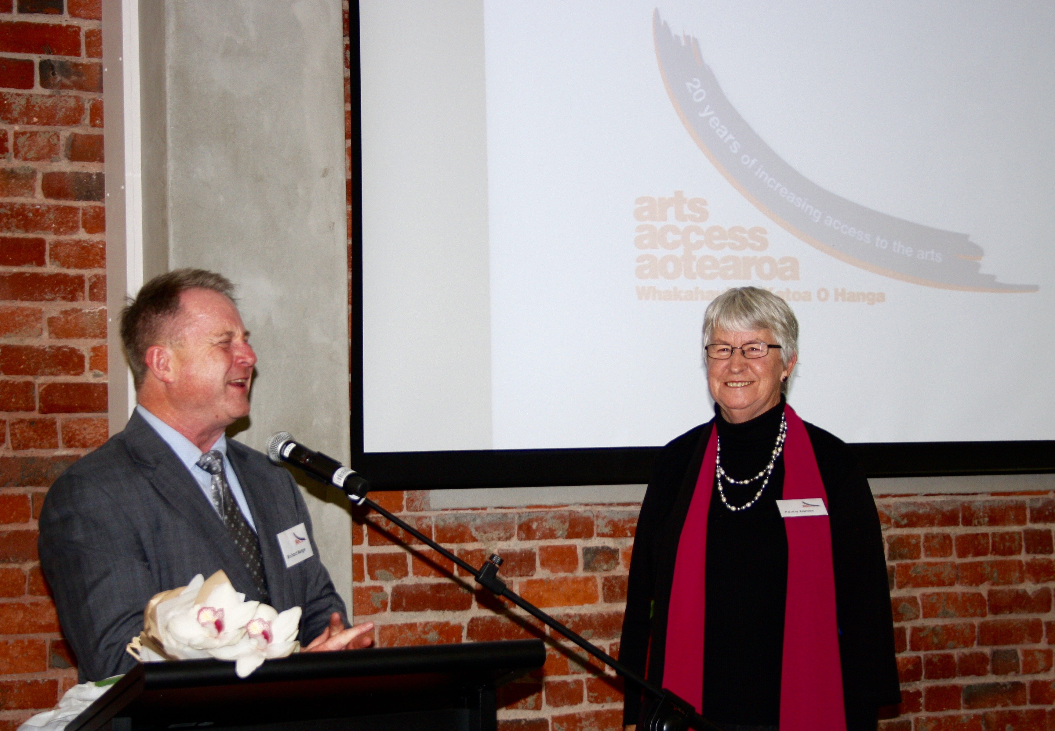 Current and founding executive directors, Richard Benge and Penny Eames sharing memories
