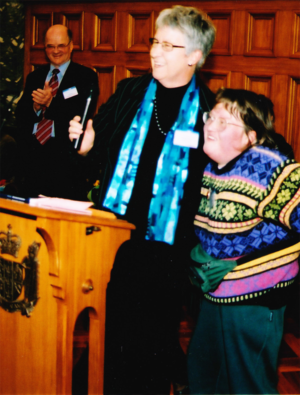 Penny Eames with artist Amy Szostack (Mel Smith CNZM in left rear) at launch of creative solution and social inclusion 2003