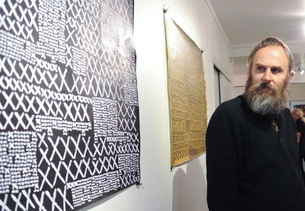 Toi Ora artist Andrew Blythe at an exhibition opening