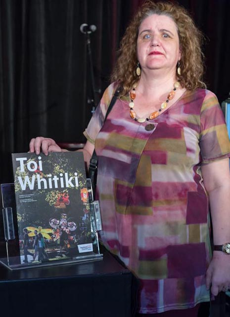Martine Abel with a copy of Toi Whitiki
