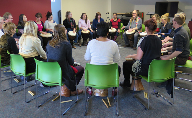 The Symposium was taken in two sessions. Here the group with Julian Raphael at the drumming workshop.