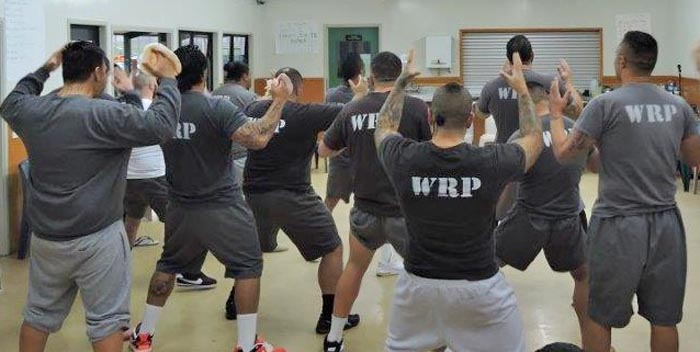 Rob Mokaraka performs a haka with the prisoners at Rimutaka Prison