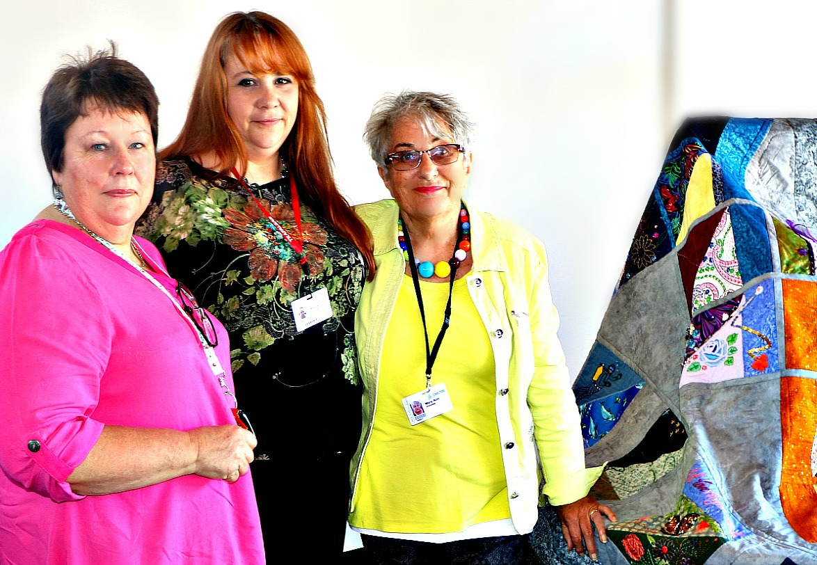 Gaye Theague, president of the Auckland Quilt Guild, and volunteers Kim Callard and Mary Ann France with Between Quilt