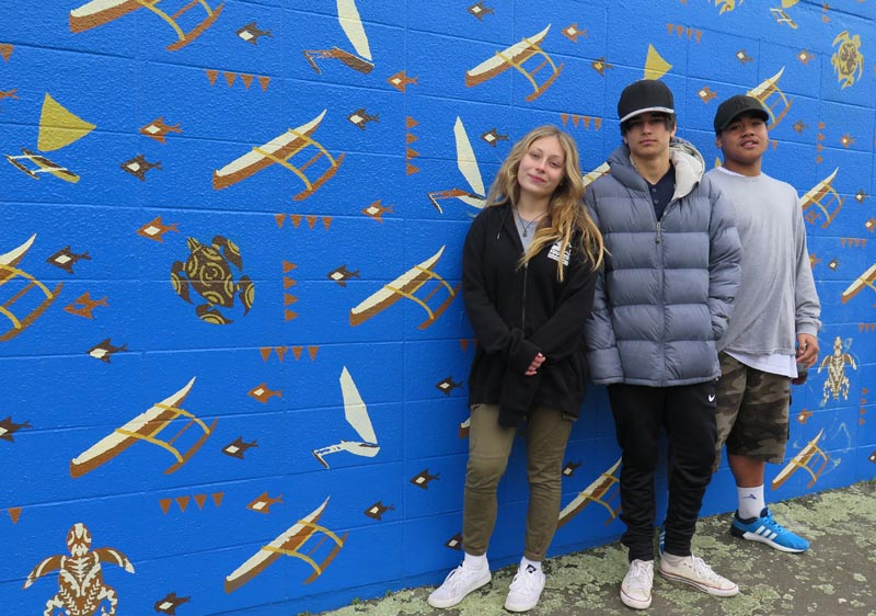 Maddy Marshall, Jonah Davis and Blaine Bethan-Taape are proud of the mural they helped paint
