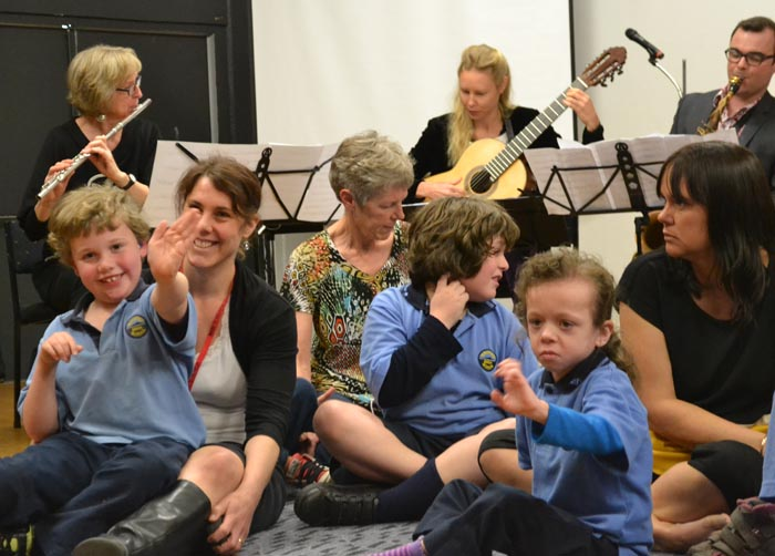 Children from Mahinawa Specialist School enjoy a relaxed performance with Trio Amistad, presented by Chamber Music New Zealand  Photo: Hannah Beattie Photography, courtesy Chamber Music New Zealand