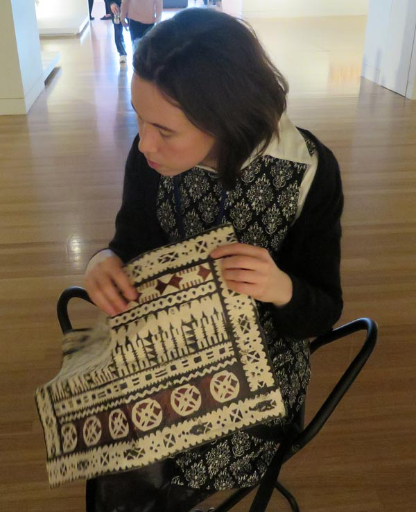 Áine Kelly-Costello touches a sample of the Fijian barkcloth called masi