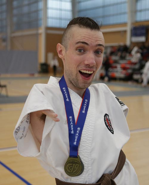 Jase Smithyman with one of his karate medals