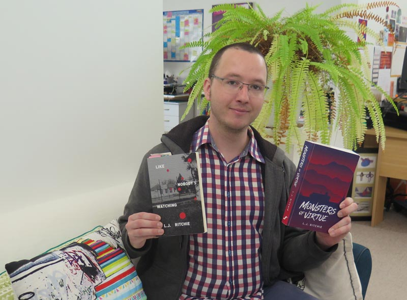L.J. Ritchie holding his two books