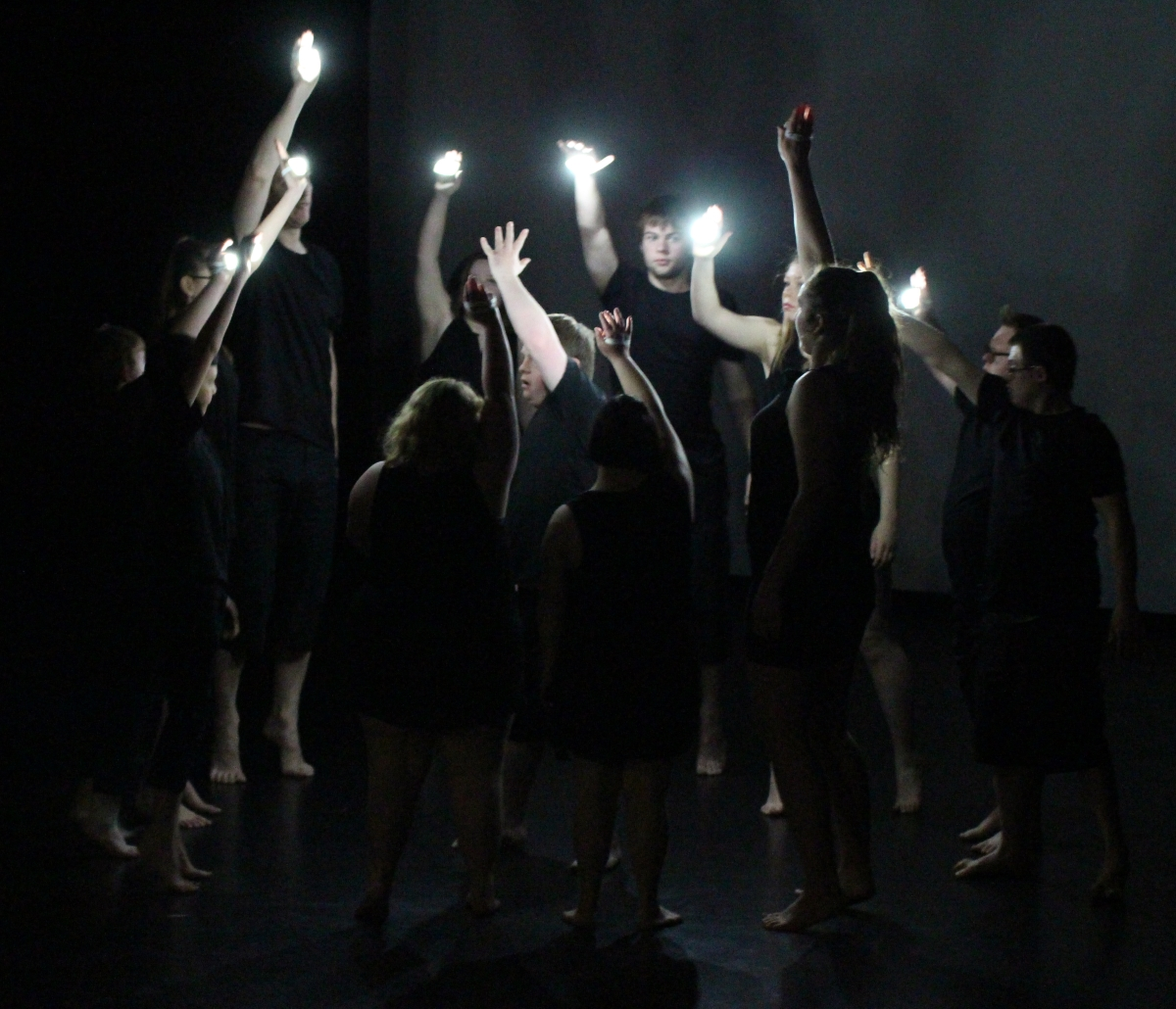 Jolt youth performing with hand lights