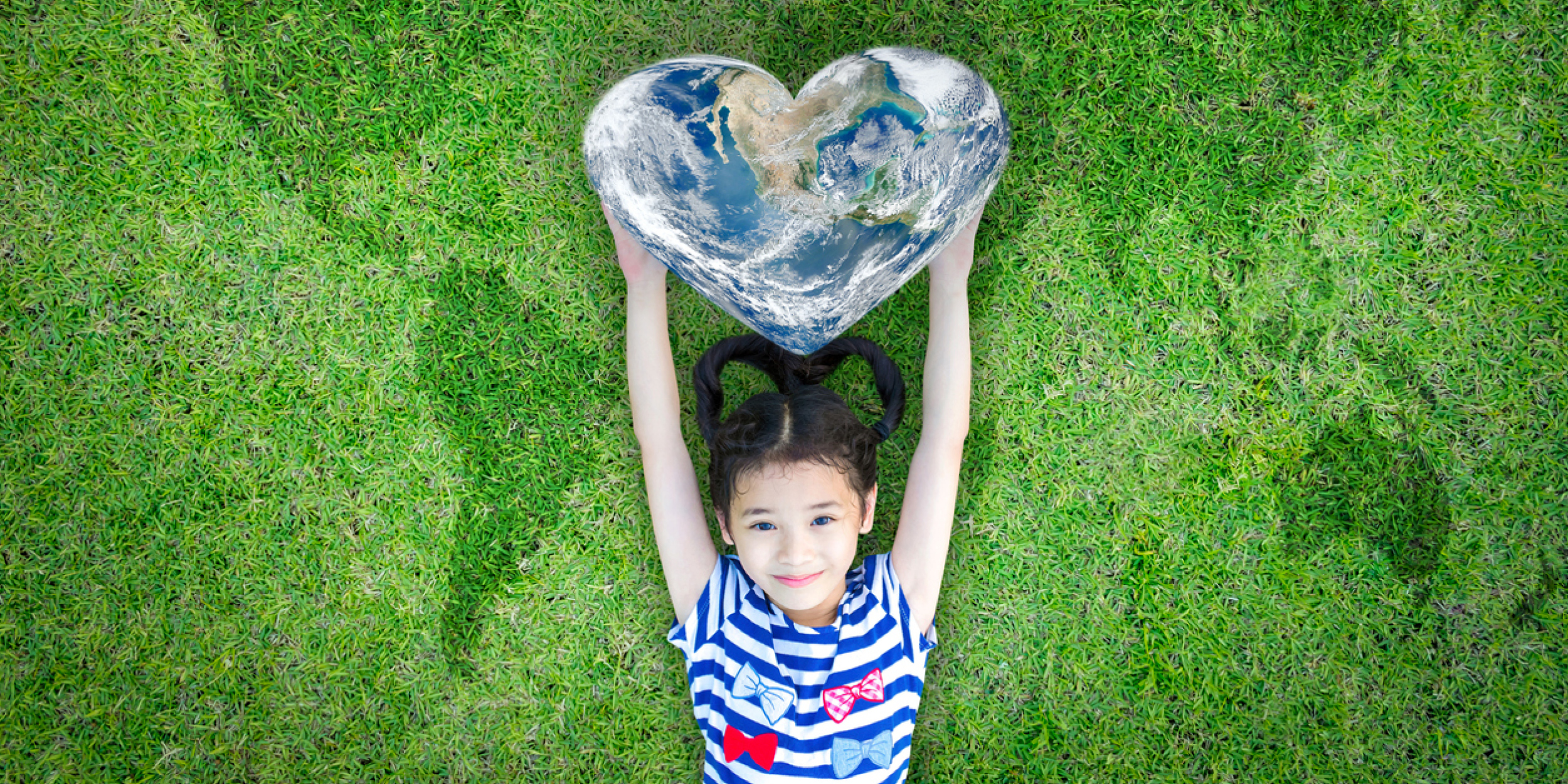 Girl holding world heart