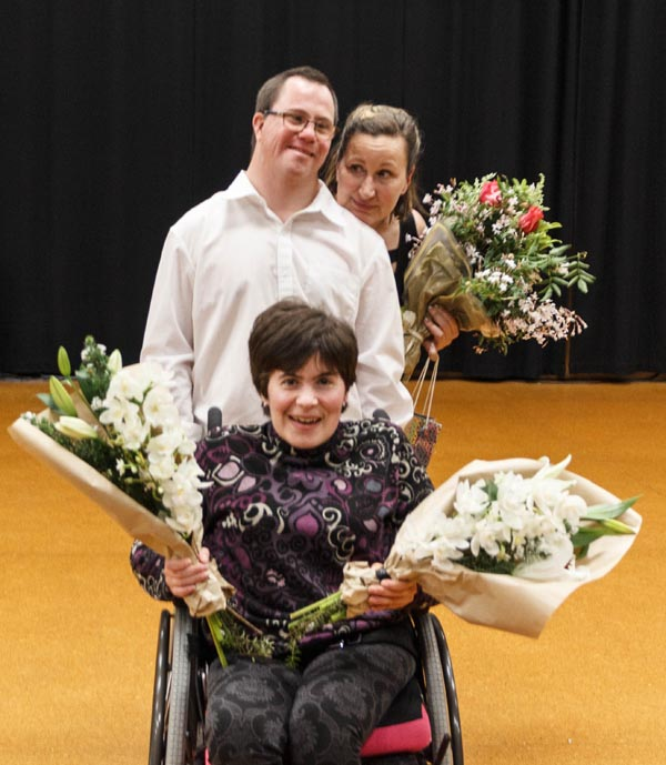 WIDance members Kezia Bennett and David Ledingham, and tutor Sumara Fraser, with some of the flower bouquets that were handed out